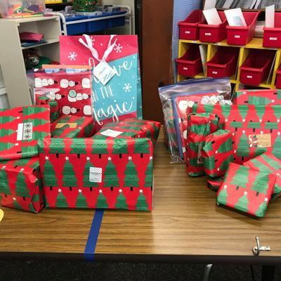 Western Elementary students, staff, spread Christmas spirit to Lexington Court Care Center residents