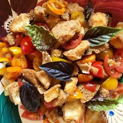 Easy-to-assemble Panzanella salad includes bread, tomatoes and fresh vegetables