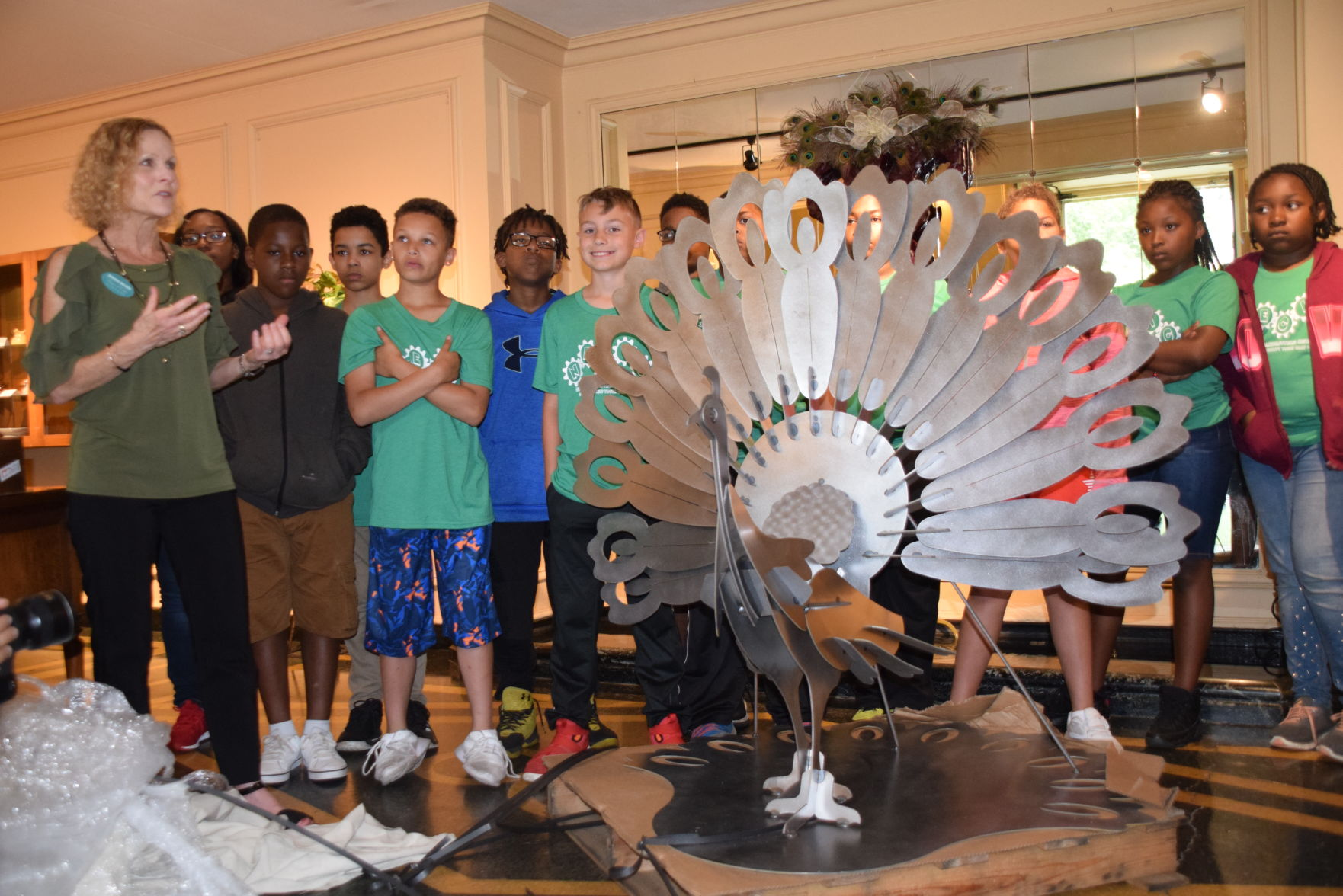 Manufacturing camp unveils peacock statue at Kingwood