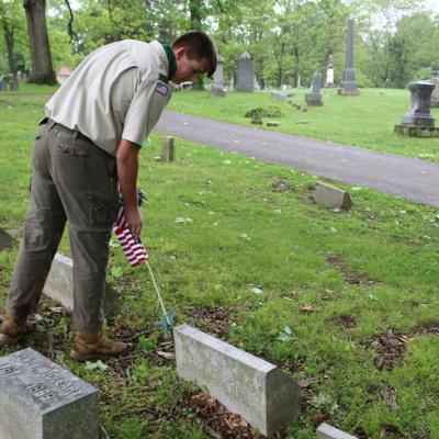 An honor to remember: Mansfield volunteers place flags on veteran graves