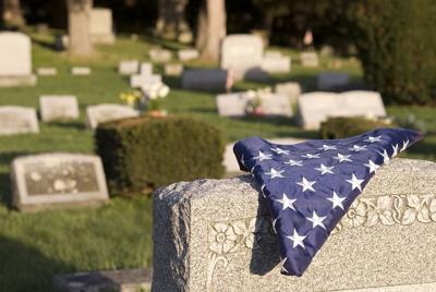 Flag draped over gravestone