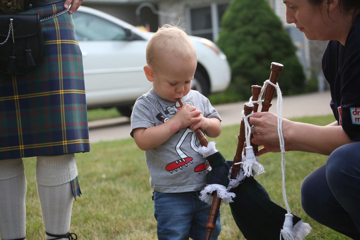 Landon Miller blows on the bagpipes