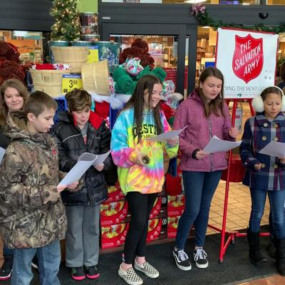 Students sing Christmas Carols in Salvation Army campaign