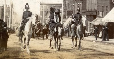 Pawnee Bill's Wild West show parading on North Main 1900