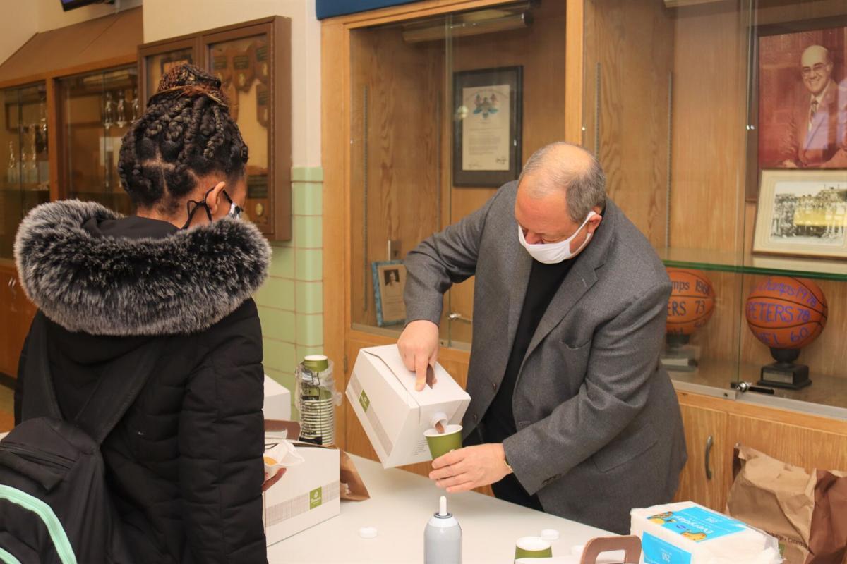 Rev. Hite pours cocoa
