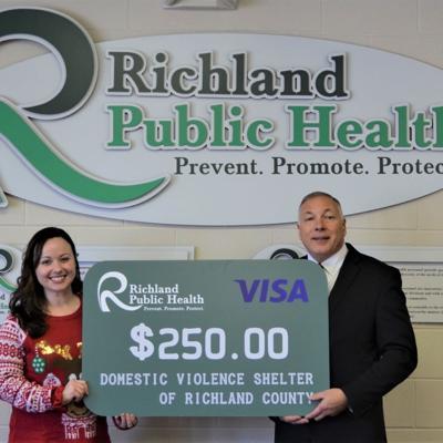 Richland Public Health donates $250 to domestic violence shelter