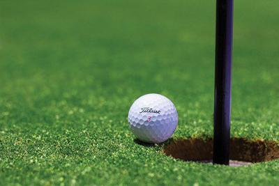 Golf ball and flag stick