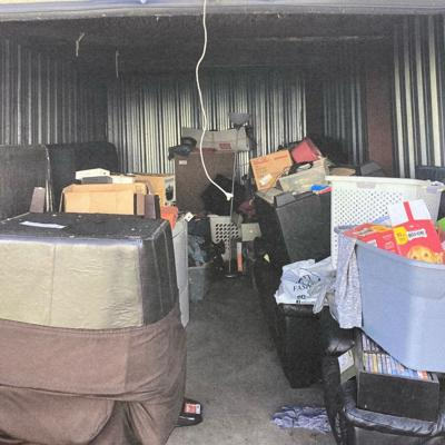 Bedframe, dresser, printer and sofas available at Lock it Up Storage auction on Oct. 23