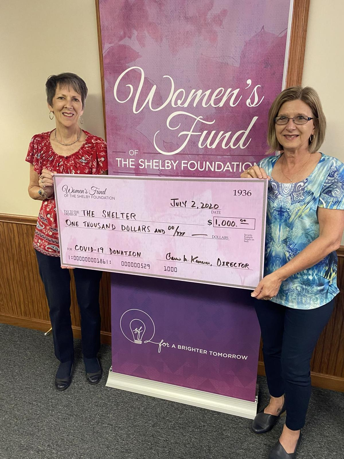 Shelby woman donate to DV shelter