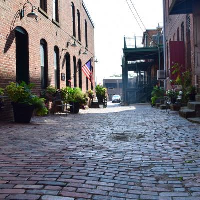 Hidden gem: Downtown businessman landscapes alley, creates popular photo backdrop
