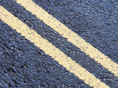 Road yellow lines stock image.jpg
