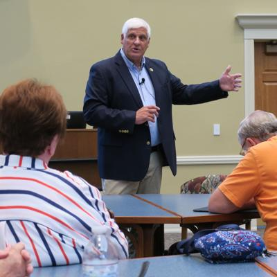 Gibbs talks guns, immigration in town hall meeting
