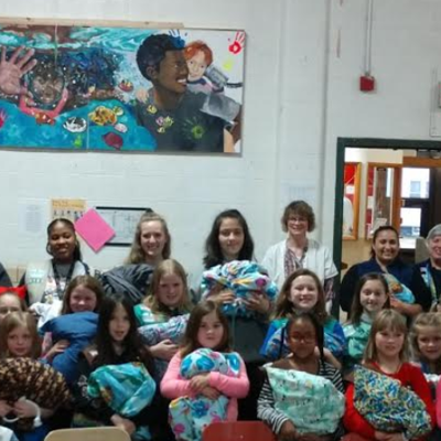 50 Girl Scouts donate hygiene items to Harmony House, Children Services