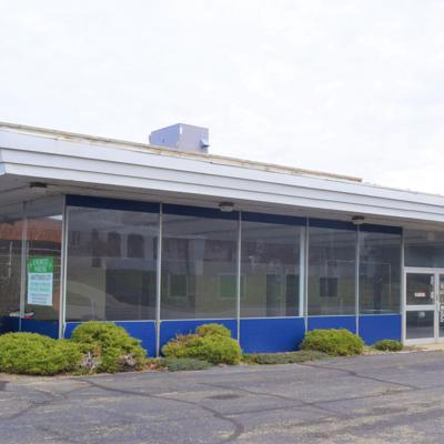 Former Spitzer auto dealership on Park Avenue West sells for $428,000