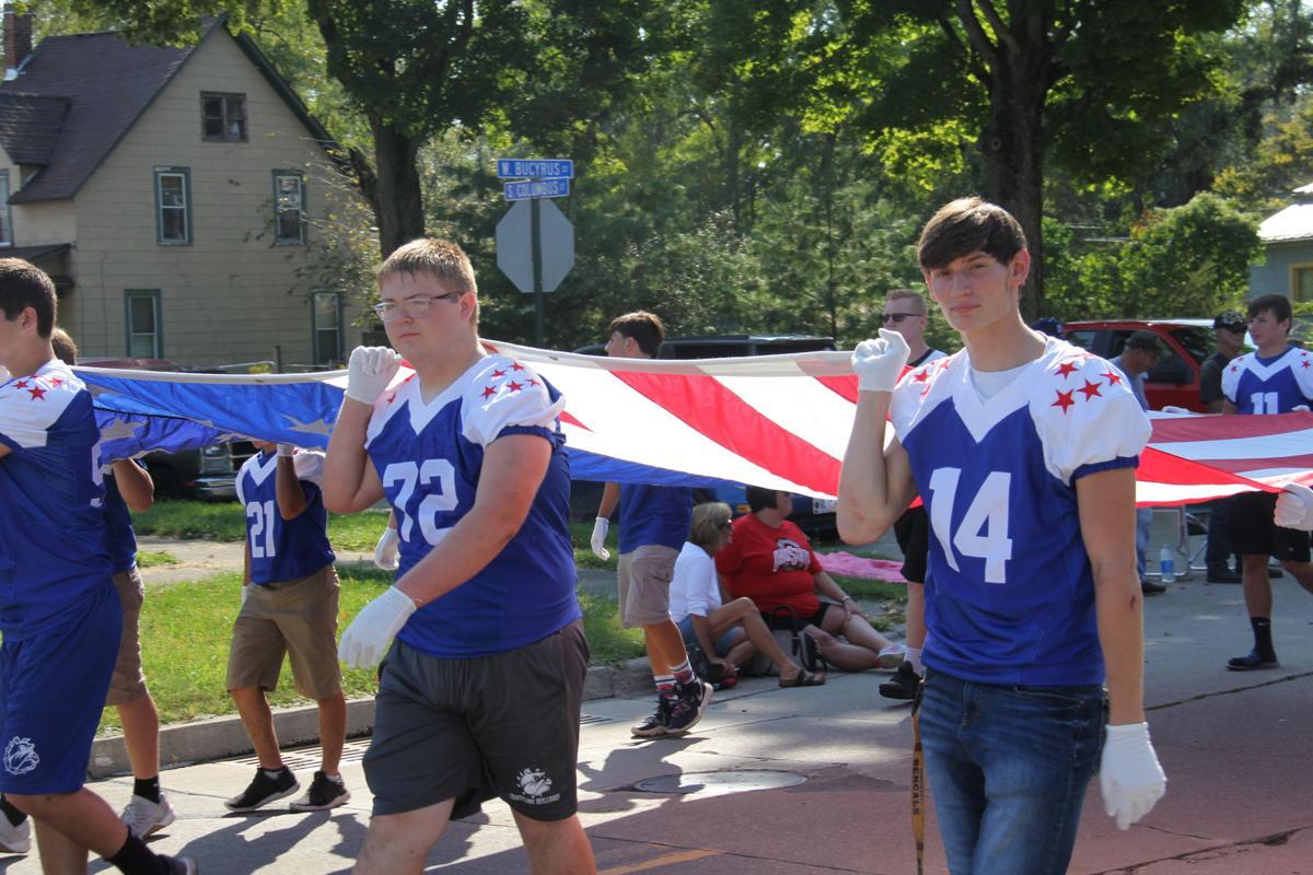 Crestline players carry the flag.JPG