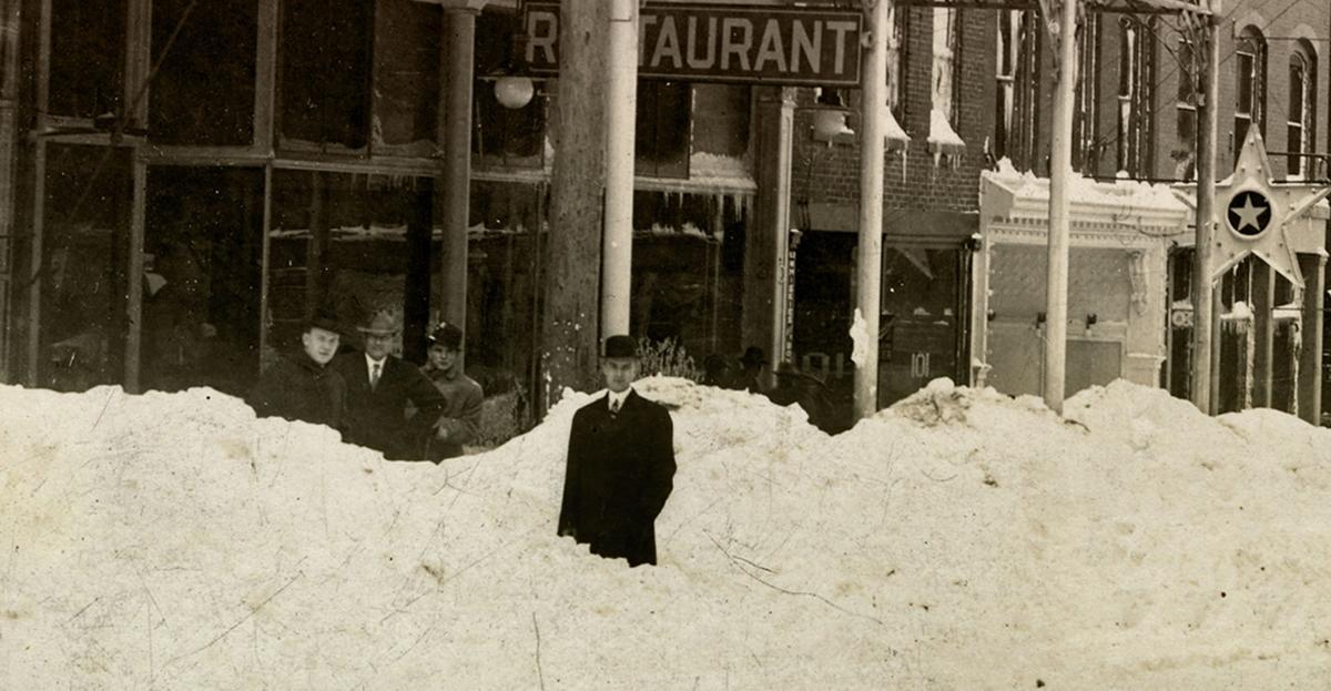 Snow piled on N. Main Street 1913
