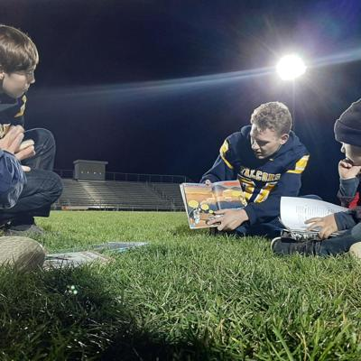 Tuesday night lights: Hillsdale football players read to elementary students