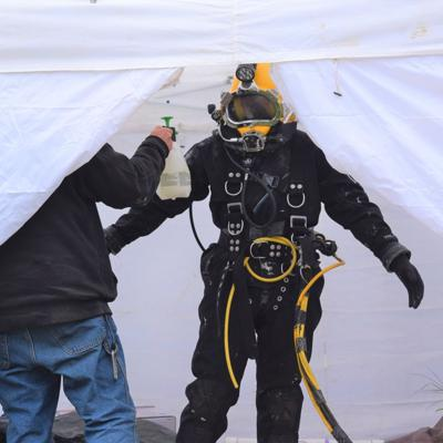 Cold temps greet divers as cleaning work begins at Mansfield Water Treatment plant