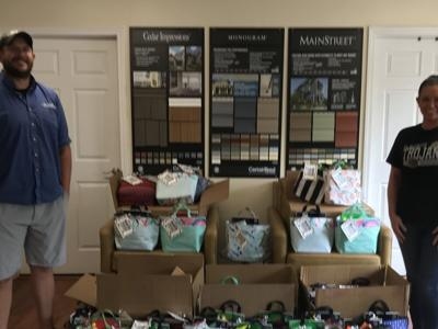 Local business donates 70 tote bags filled with school supplies to South Central School District