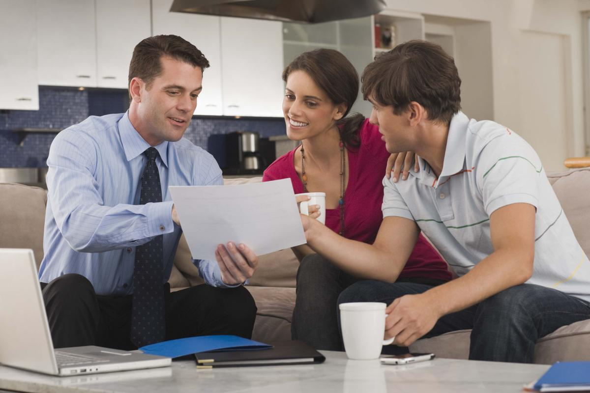 financial planner with young couple