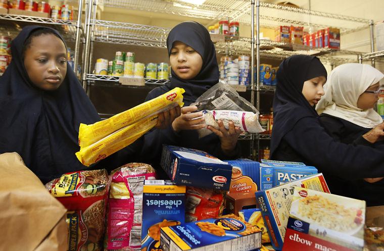 Muslim students help stock food pantry at Episcopal church