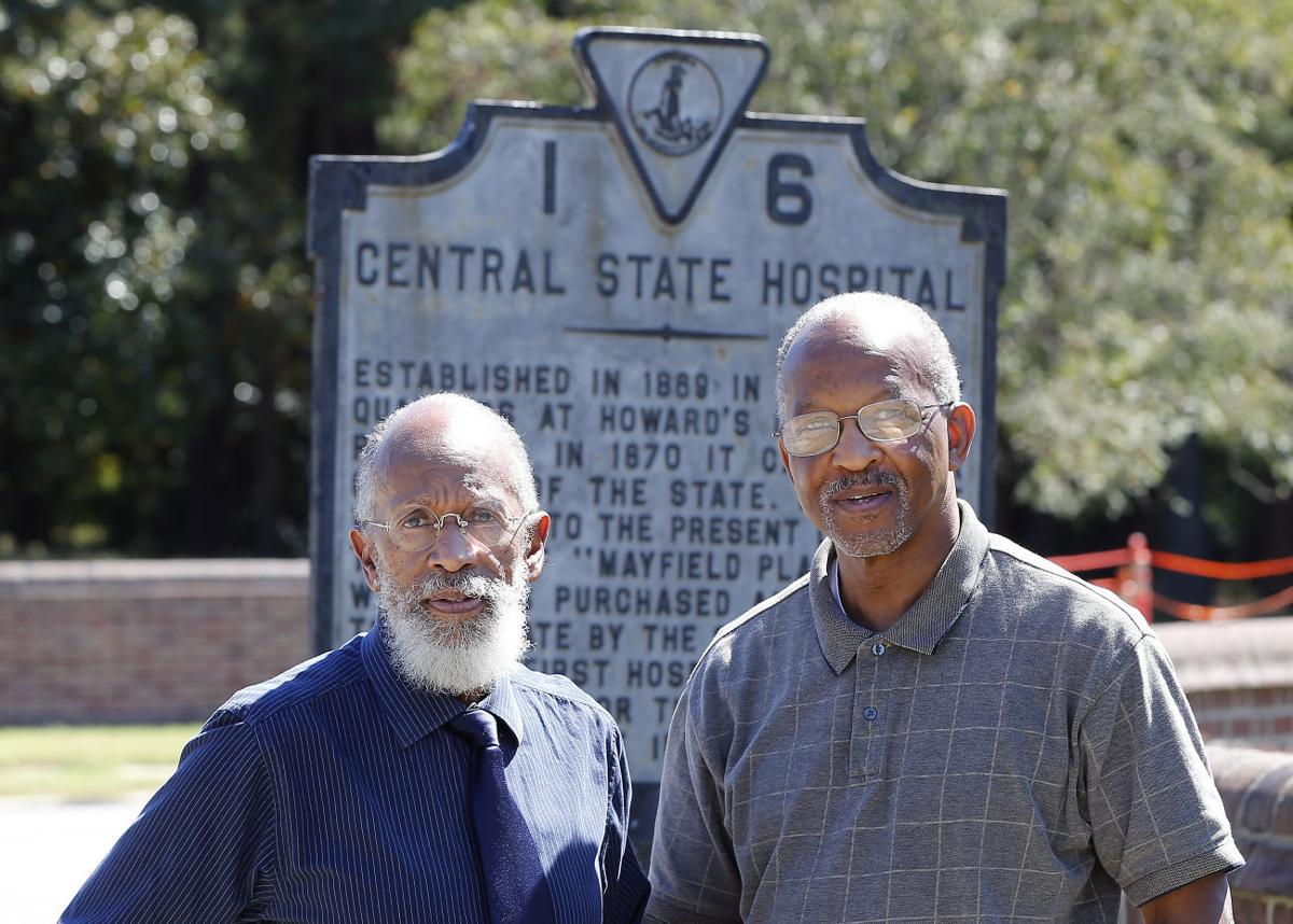 King Davis, Ph.D. and Dr. Ronald O. Forbes at a marker in front of Central State