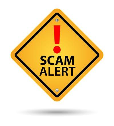 Yellow scam alert sign