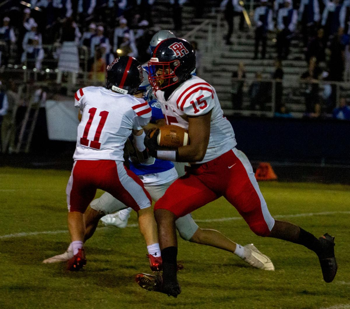 Patrick Henry at Atlee football: Berry gets a block