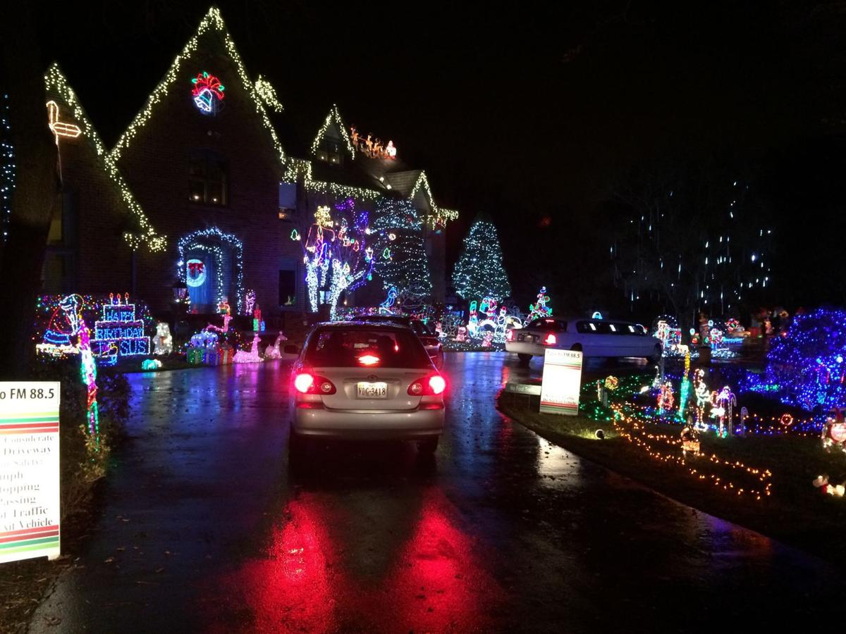 Image result for Tacky Light houses lighting up for Thanksgiving, several homes going dark