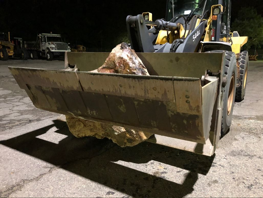 Highway crew recovers boulder that triggered wreck