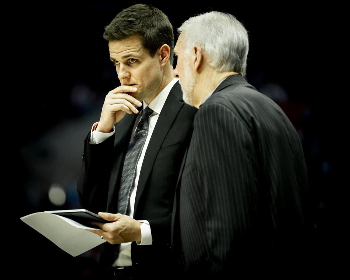Will Hardy and Popovich discuss strategy.jpg