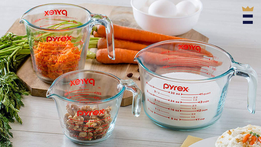 Liquid measuring cups are clear for a good reason-- so you can see whether the liquid meets the measuring line.