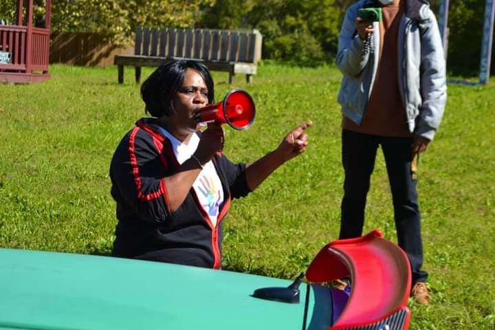 "Pastor Belinda Baugh addresses community residents during recent ""City of Hope'"" march"