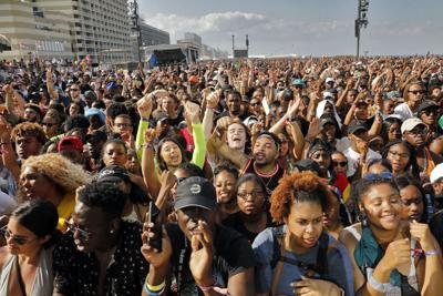 """Fans cheer as Pusha-T performs during the Something in the Water festival in April 2019. Citing a """"toxic energy"""" in Virginia Beach, organizer Pharrell Williams has opted to not bring the festival back. Fans plan a """"sit-down"""" next month to show support for the star musician and Virginia Beach native.  Jonathon Gruenke/staff file"""