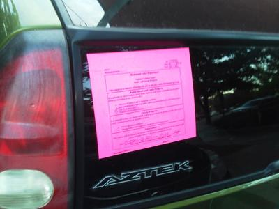 Pink Window Tag Illegally Parked