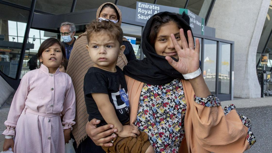 Image Afghan evacuation operation 'drawing down' near Dulles, but thousands still waiting to enter U.S.