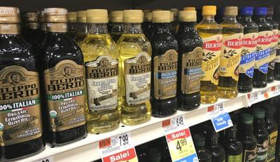 Closeup of olive oils on shelf
