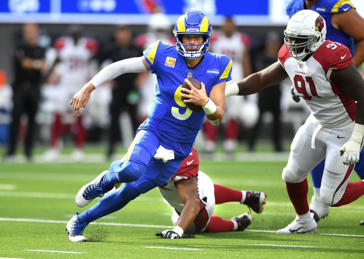 Rams quarterback Matthew Stafford scrambles for a first down against the Cardinals in the fourth quarter at SoFi Stadium on October 3, 2021.