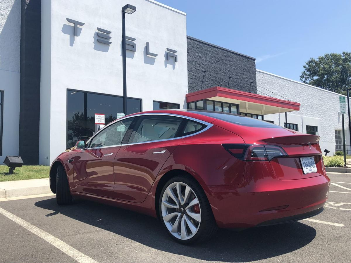 tesla store in henrico marks one year in business with jump in model 3 deliveries legal dispute remains business news richmond com tesla store in henrico marks one year