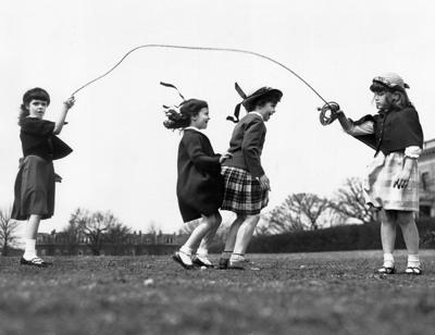 In March 1950, four girls played jump-rope in a Richmond city park.
