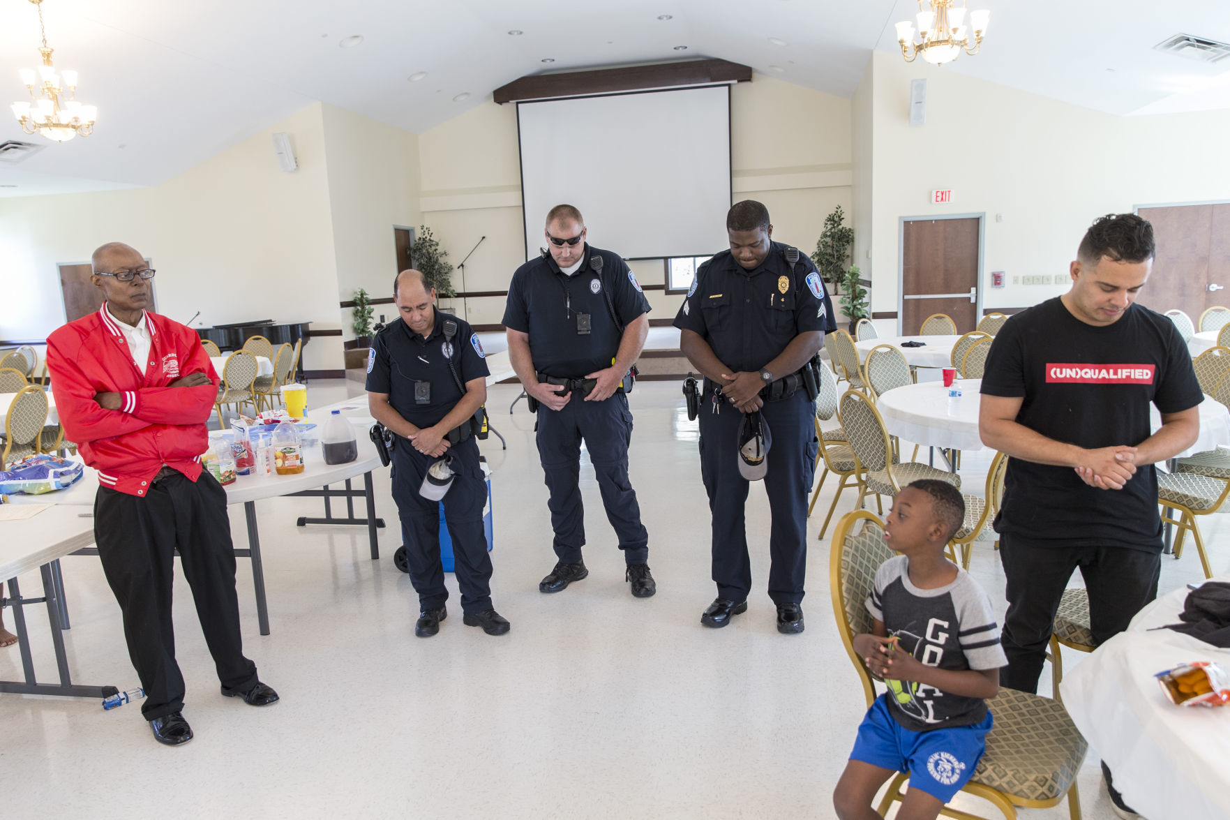 Richmond Police Officers (second From Left), Keary Lightfoot, Bruce Larka  And Sgt. Eric Allen, Pray With Tommy Cox (left), A Volunteer Of The  Guardian ...