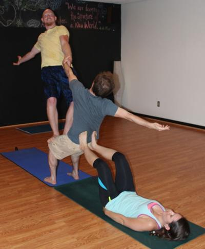 fitness acrobatic yoga can be intimidating to newcomers