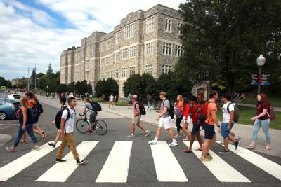 Virginia Tech students cross Drillfield Drive