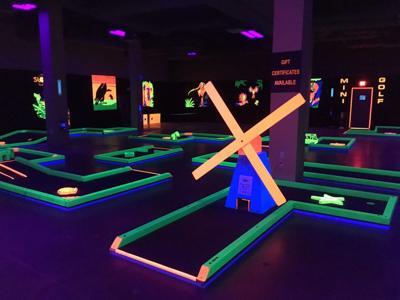 Glowgolf offers mini golf under the glow of black lights in