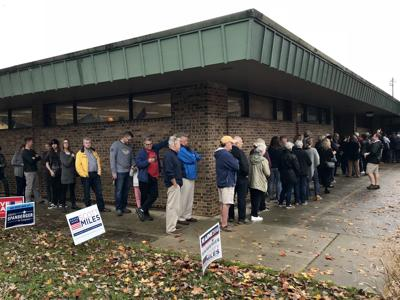 Voters line up to cast ballots at Robious Elementary School in Midlothian.