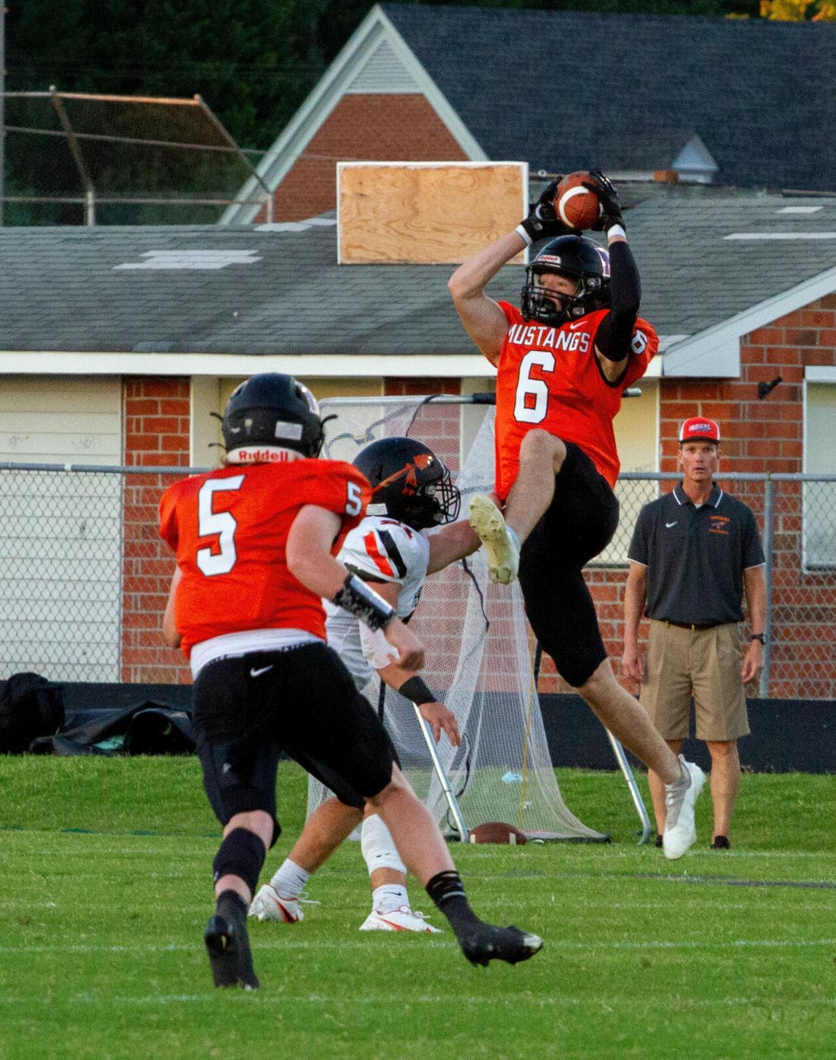 Powhatan at Mechanicsville football: Bidou hauls one in