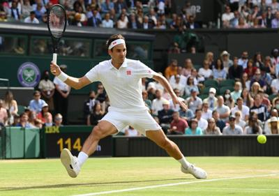 Roger Federer of Switzerland plays a forehand during his third-round match against Cameron Norrie of Great Britain during Wimbledon at All England Lawn Tennis and Croquet Club on Saturday, July 3, 2021 in London.