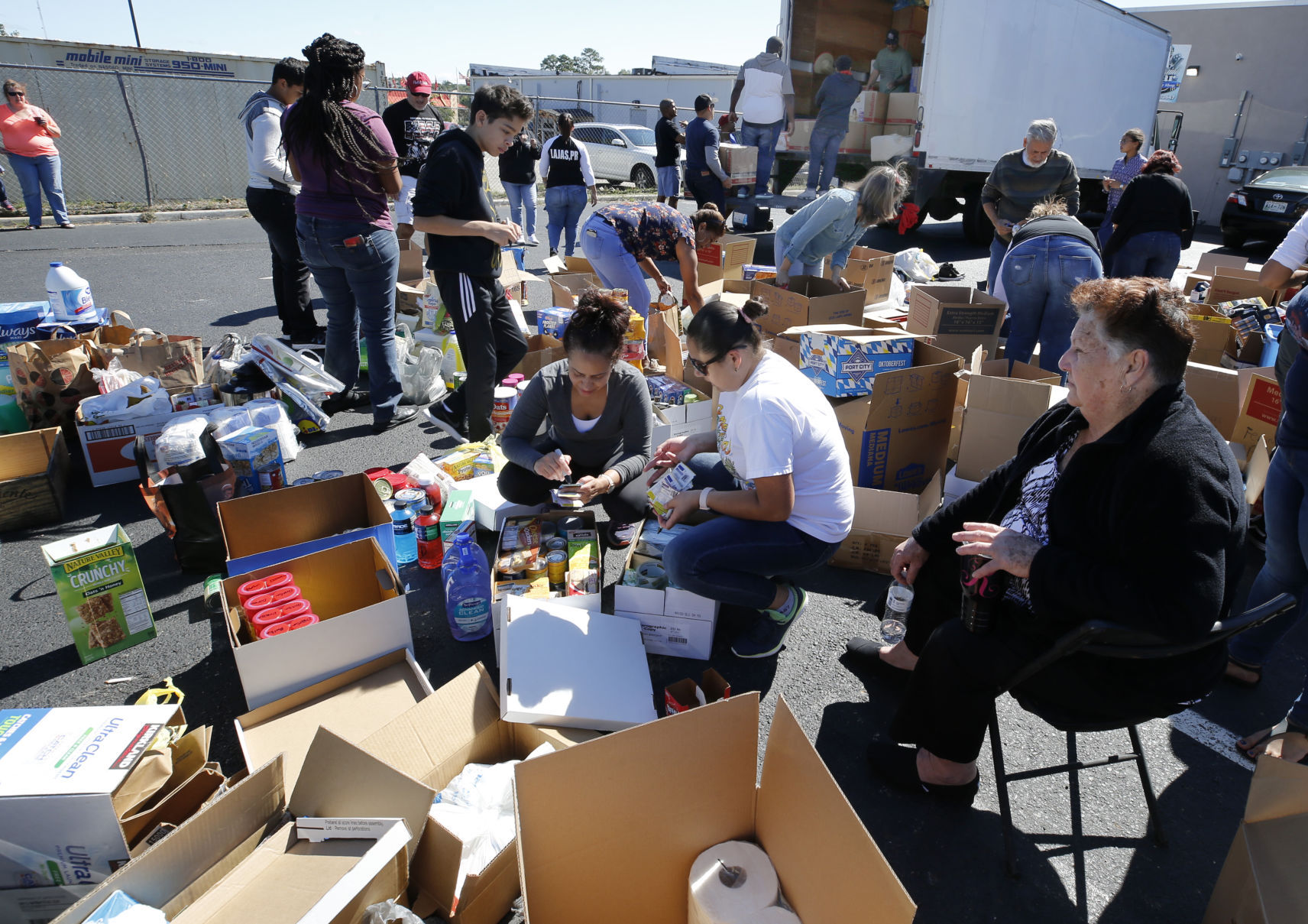 Locals continue gathering supplies for Puerto Rico as federal response questioned