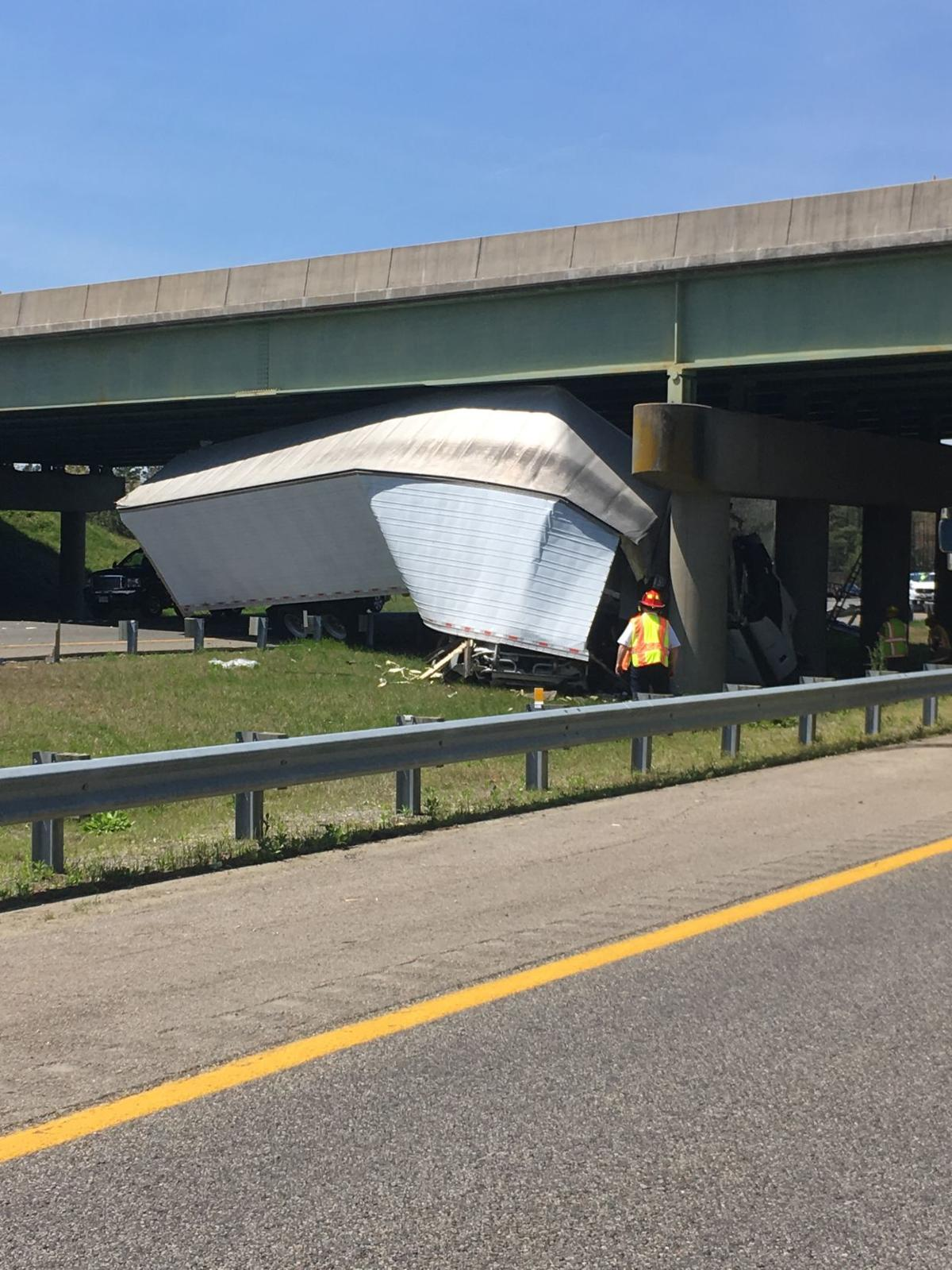 UPDATE: Driver dies after being trapped when two tractor trailers
