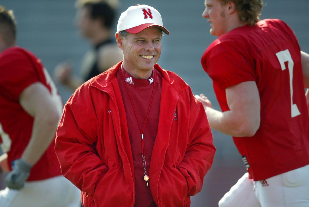 University of Nebraska football players run by coach Frank Solich as they  warm up in Memorial Stadium in Lincoln d36e9d6a8ef2